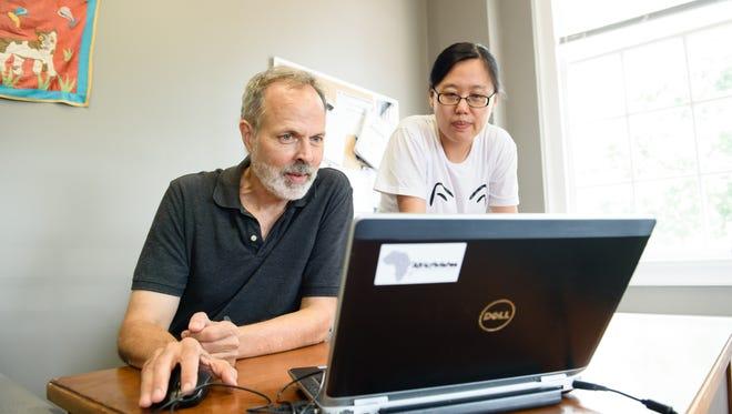 Dr. Richard Brooks and postdoctoral researcher Lu Yu  working on their development.