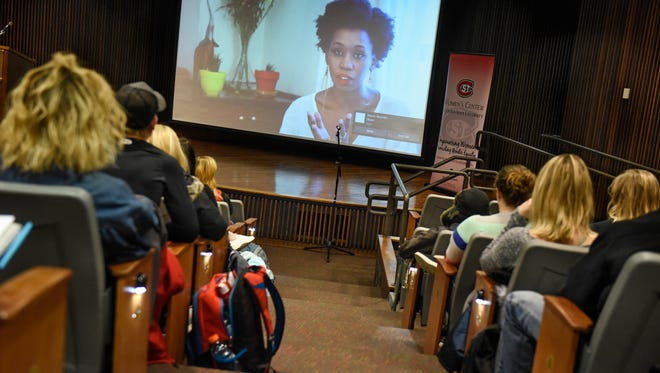 Kari Mugo speaks via video from Nairobi, Kenya, during a Women on Wednesday presentation Wednesday, March 14, 2018, at St. Cloud State University. Mugo spoke on the role of gun violence in domestic abuse.