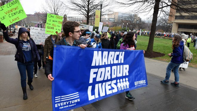 Demonstrators march to Circle Park during the student March for Our Lives demonstration against gun violence Saturday, March 24, 2018 at the Humanities Plaza amphitheater on the UTK campus.