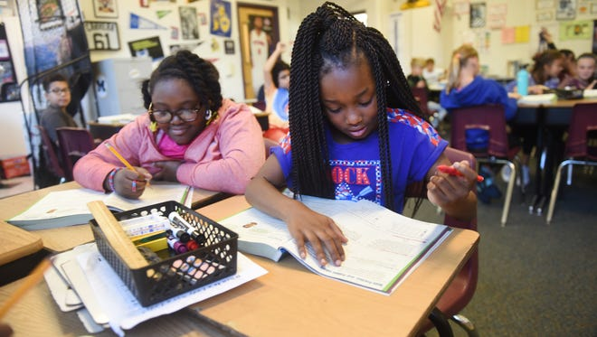 Ferndale Upper Elementary School students Savanna Taylor (right) and Brianna Davisyoung  complete their classroom assignment at the Oak Park campus on Wednesday September 14, 2017. 