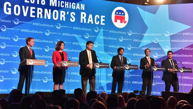 Michigan gubernatorial candidates (from left) Bill Schuette (R), Gretchen Whitmer (D), Pat Colbeck (R), Shri Thanedar (D), Brian Calley (R) and Abdul El-Sayed (D) debate the issues on stage at the Mackinac Policy Conference on Mackinac Island on Thursday, May 31, 2018.