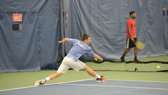 Geneva's Ryan Fishback slides for a shot at the New York State Championships in Flushing, NY.