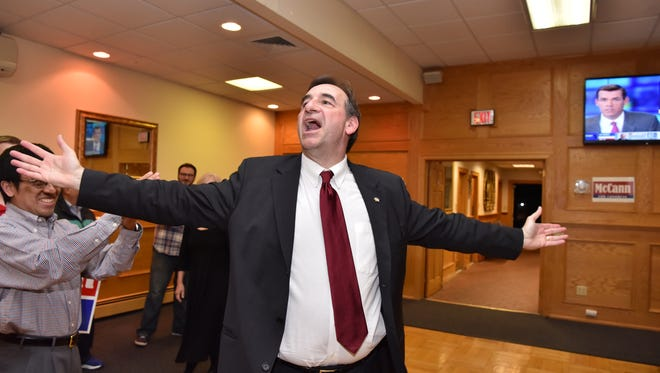 John McCann celebrates victory in Ramsey