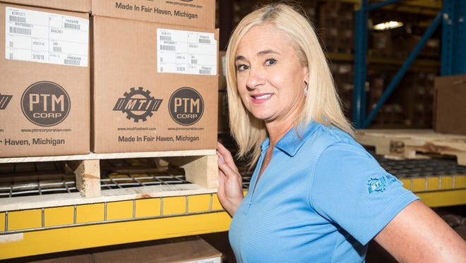 Donna Russell-Kuhr, pictured Tuesday, June 5, 2018, in one of PTM Corporation's Ira Township warehouses. Russell-Kuhr is co-owner and president of PTM Corporation, a metal stamping plant, and is president of the Economic Development Alliance of St. Clair County.