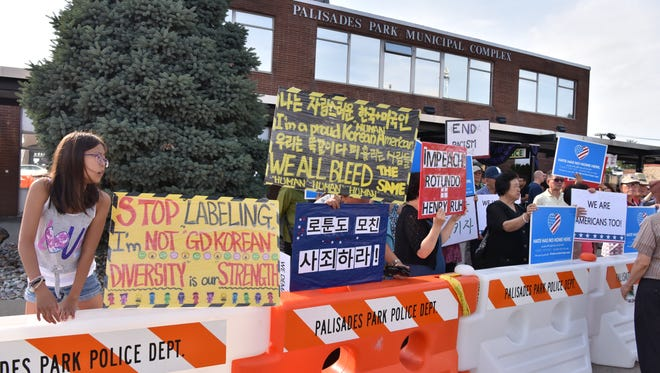 The Korean and the LGBT community rally against the current political climate in Palisade Park, NJ, on Tuesday, June 26.