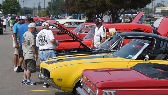 People get a close up view of the many cars on display for the Downriver Dream Cruise in Southgate on Saturday, June 30, 2018