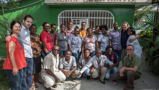 Staffers of the Lamp for Haiti medical clinic, along with volunteers and Dr. James Morgan, second from left, who founded Lamp for Haiti.