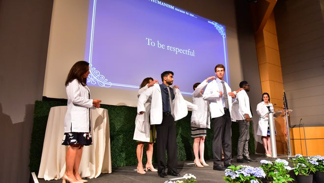 First-year students received their coats and vowed to bring compassion and humanity to medical care during a ceremony at Seton Hall Medical School in Nutley.