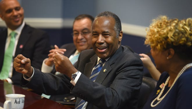 U.S. Department of Housing and Urban Development Secretary Ben Carson (center) gets pumped up during a roundtable discussion at theMariners Inn, shelter and treatment center for the homeless, in Detroit on Thursday, July 18, 2018.