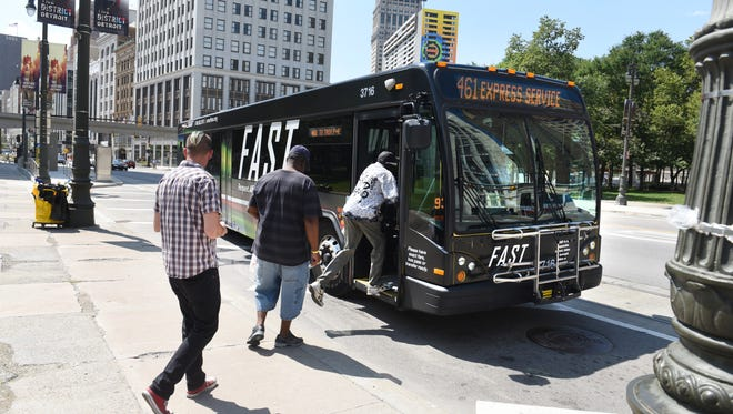 A SMART FAST bus picks up riders along northbound Woodward Avenue at Grand Circus on Thursday, July 26, 2018. A renewal will be on the August ballot. 