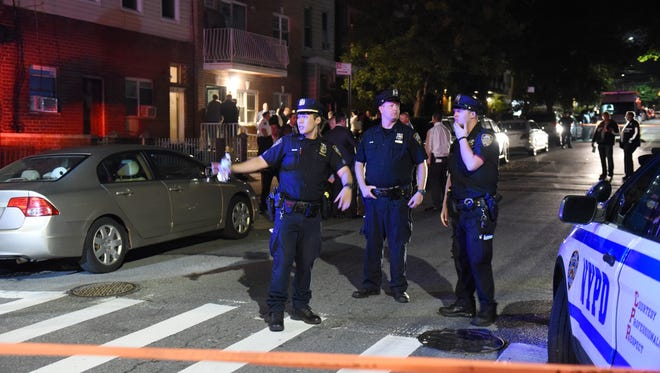 Police at the scene where four people were fatally shot in an apartment building located on 30th Drive in Queens, NY around 9:30 p.m. on July 30, 2018.