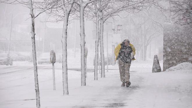 Heavy blowing snow in downtown Lansing Thursday Feb. 20, 2014.      (Lansing State Journal   Rod Sanford)