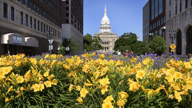 A view down Michigan Avenue towards the State Capitol Building in Lansing Friday  6/27/2014.