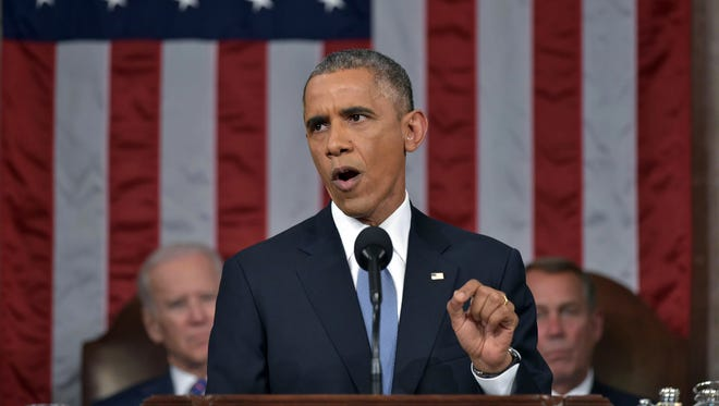 President Barack Obama delivers his State of the Union address to a joint session of Congress on Capitol Hill on Tuesday, Jan. 20, 2015, in Washington. Vice President Joe Biden (left) and House Speaker John Boehner of Ohio, listen in the background.