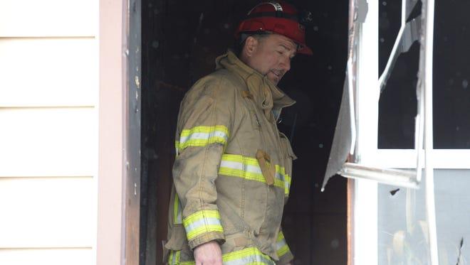 A Green Bay Fire Department fire marshal inspects 410 W. 15th Avenue which was heavily damaged by fire November 11, 2014.
