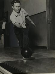 Ned Day, world match bowling champion, sends the ball
