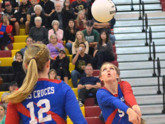 Las Cruces High's Sarah Abney gets ready to set up a teammate during Saturday's District 3-6A championship match at CHS