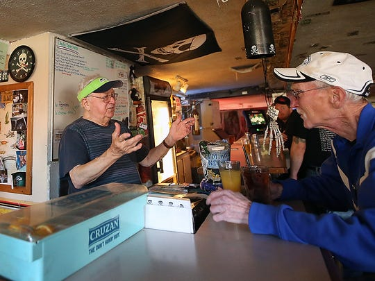 Owner Fred Lanouette, left, chats with customer Robert Maner at the Old Town Pub in Silverdale.