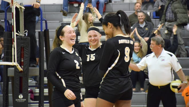"As the Village People's song ""Y.M.C.A."" plays, Buffalo Gap's Natalie Robertson, left, and Amaya Lucas, right, laugh as teammate Camille Ashby joins the fans in spelling out the letters during a break in their quarterfinal match against Stuarts Draft in the Shenandoah District Volleyball Tournament at Buffalo Gap High School in Buffalo Gap, Va., on Monday, Oct. 30, 2017."