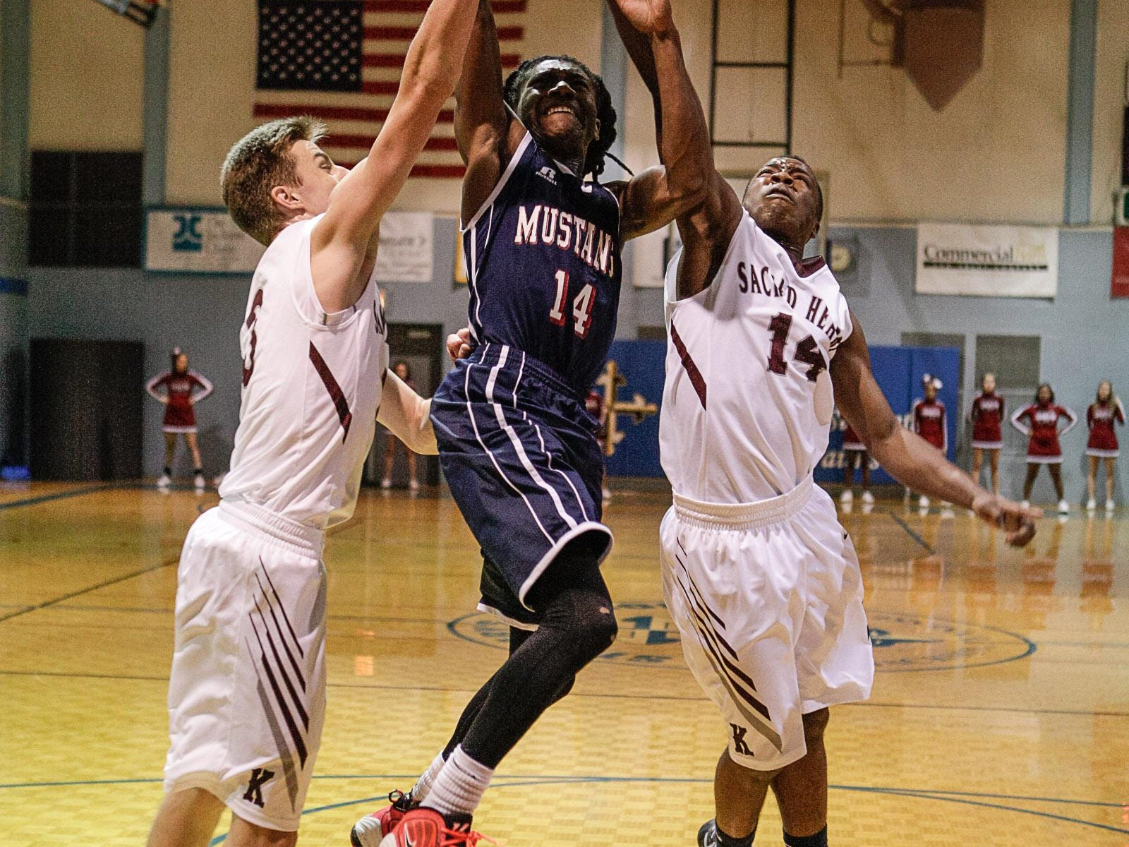 Madison's Marquese Parram goes up for a shot Friday against Sacred Heart.