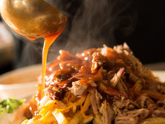 At BJ's Barbecue, housemade barbecue sauce finishes