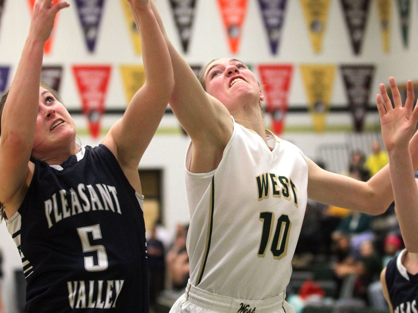 West High's Ali Tauchen tries to pull in a rebound during the Women of Troy's Class 5A regional final against Pleasant Valley on Tuesday, Feb. 24, 2015. West High won, 45-27, to advance to the state tournament. David Scrivner / Iowa City Press-Citizen