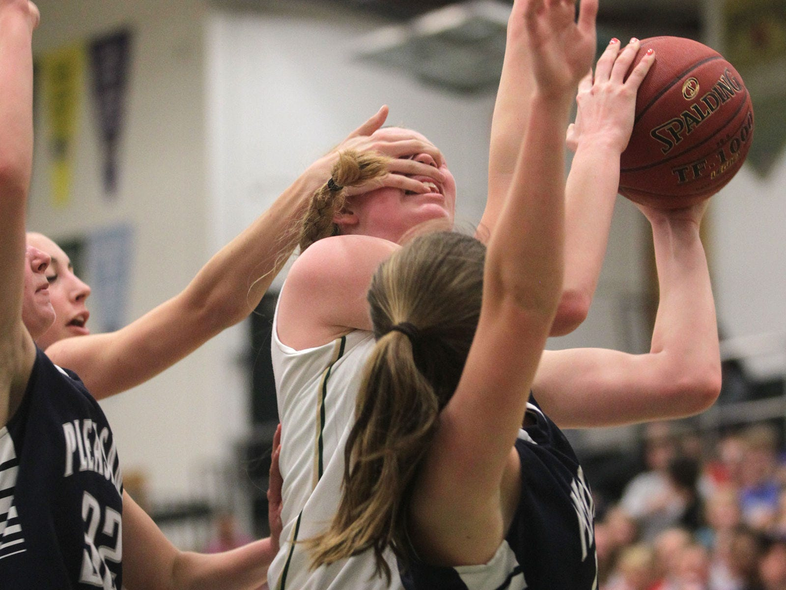West High's Emily Halverson draws a foul during the Women of Troy's Class 5A regional final against Pleasant Valley on Tuesday, Feb. 24, 2015. West High won, 45-27, to advance to the state tournament. David Scrivner / Iowa City Press-Citizen