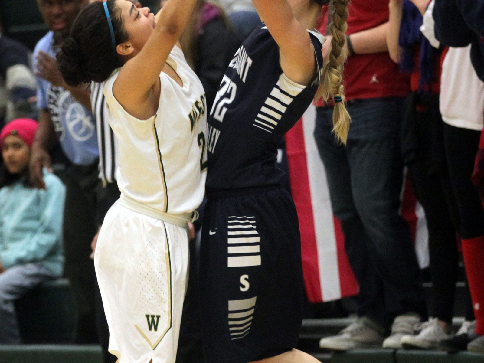West High's Bella Lozano-Dobbs guards Pleasant Valley's Ellie Spelhaug during their Class 5A regional final on Tuesday, Feb. 24, 2015. West High won, 45-27, to advance to the state tournament. David Scrivner / Iowa City Press-Citizen