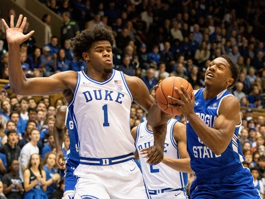 Georgia State's Kane Williams, right, drives against Duke's Vernon Carey Jr. (1) during the first half of an NCAA college basketball game in Durham, N.C., Friday, Nov. 15, 2019. (AP Photo/Ben McKeown)