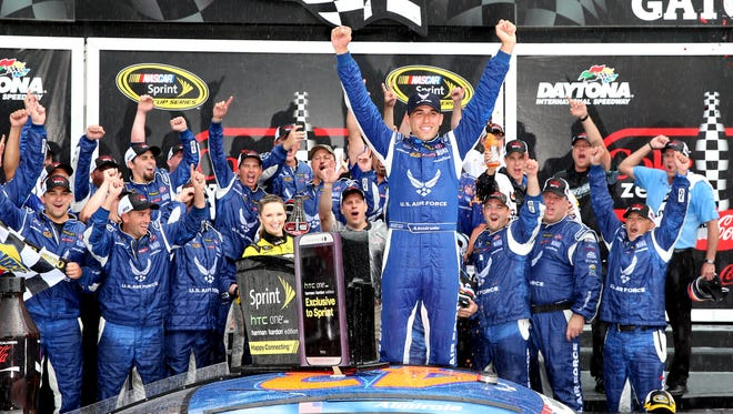Aric Almirola celebrates in victory lane after being declared the winner of the Coke Zero 400 after the race was called because of rain.