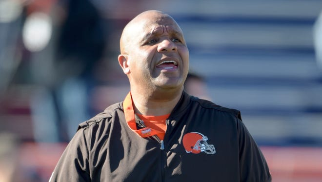 South squad head coach Hue Jackson of the Cleveland Browns talks with his players during practice at Ladd-Peebles Stadium.