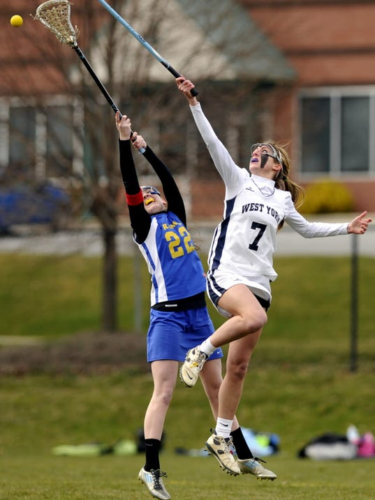 Kennard-Dale's Morgan Day and West York's Allee Ilgenfritz fight for the draw during a girls' lacrosse  match last season. (GAMETIMEPA.COM -- CHRIS DUNN)