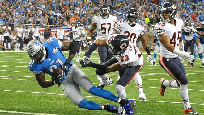 Lions receiver Calvin Johnson, left, reached the 10,000-yard mark for his career in 115 games.