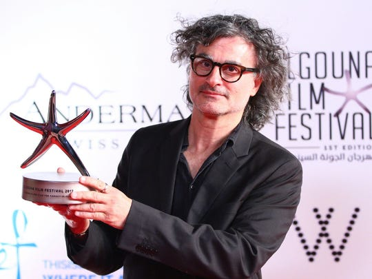 Ziad Doueiri poses with his Silver Star for Best Feature