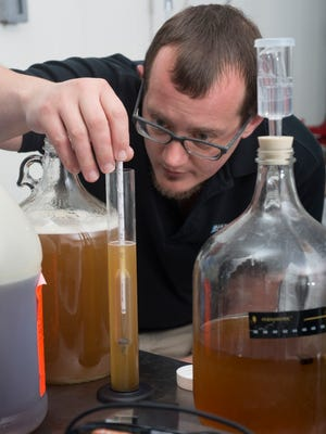Pensacola resident John Wilson tests the sugar and alcohol content of a batch of mead during brewing process Wednesday morning April 19, 2017. Wilson has perfected his brewing process of the honey wine and is planning to open a new mead brewery on Nine Mile Road in early July.