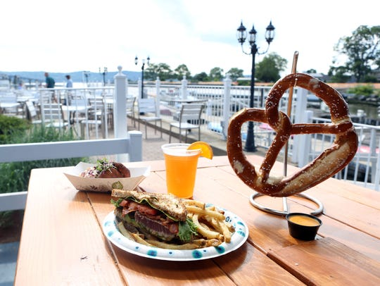 The Wicked tuna sandwich, crab cakes and pretzel, some