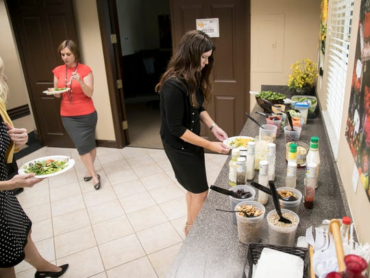 Brenda Wright gets her salad from the salad bar at Markham Norton Mosteller Wright & Company on Friday, July 6, 2018, in Fort Myers.