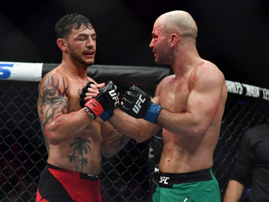 Cub Swanson (red gloves) defeats Artem Lobov (blue gloves) during UFC Fight Night at Bridgestone Arena.