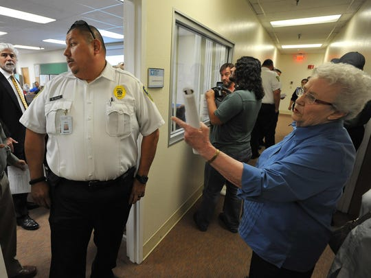 Tulare community members ask to be let into the Tulare Regional Medical Center board of directors meeting in the Allied Services building on Wednesday, April 27, 2016.
