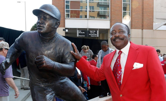 Hall of Fame second baseman Joe Morgan poses with his statue that was unveiled at Great American Ball Park.