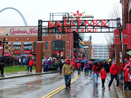 April 7: Fans walk around Ball Park Village before Opening Day at Busch Stadium between the St. Louis Cardinals and the Cincinnati Reds.
