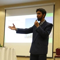 Dr. Sabeel Ahmed of Chicago gestures as he talks about Islam during his presentation at the Holiday Inn in Marshfield, Saturday, May 2, 2015. The local Moslem community is thinking about locating a Mosque in Wausau.