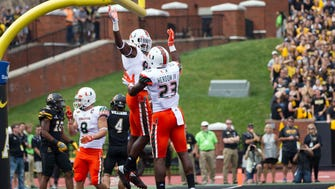 The unbeaten Miami Hurricanes are up to No. 14 in the Amway Coaches Poll.