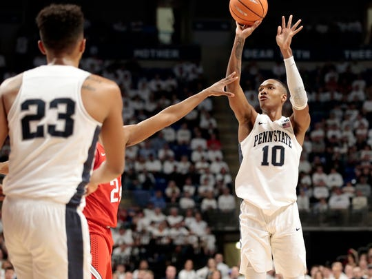Penn State's Tony Carr (10) knocks down a three-point basket against Ohio State during the first half of an NCAA college basketball game in State College, Pa., Thursday, Feb. 15, 2018. (AP Photo/Chris Knight)