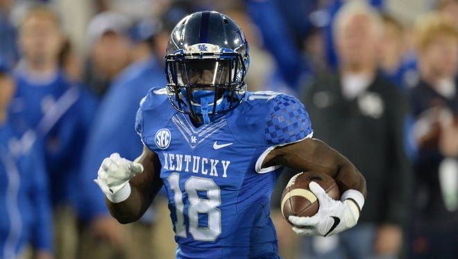 UK RB Boom Williams runs during the first half of the University of Kentucky - Auburn football game at Commonwealth Stadium in Lexington, Ky., on Thursday, October 15, 2015. Photo by Mike Weaver