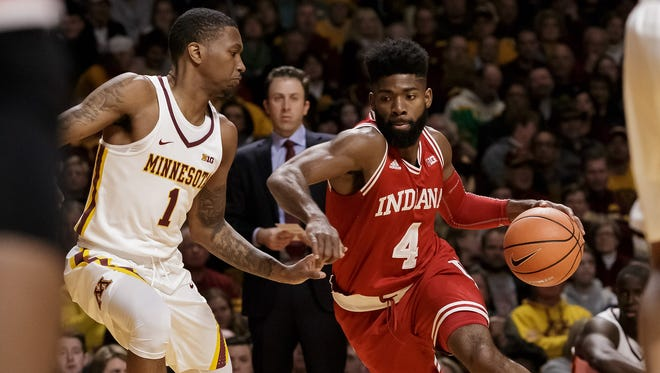 Hoosiers guard Robert Johnson (4) dribbles in the first quarter against the Minnesota Gophers guard Dupree McBrayer (1) at Williams Arena.