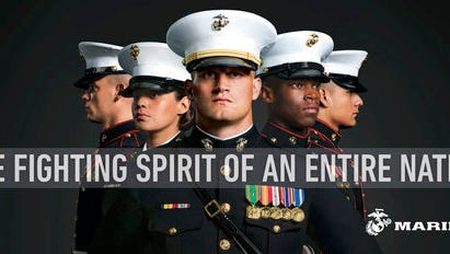 """This undated image provided by the U.S. Marine Corps shows a billboard that the Corps will post as part of a new recruitment advertisement campaign, meant to draw millennials by showing Marines as not only strong warriors but good citizens. """"Battles Won"""" is the name of the campaign that includes TV ads and online clips of Marines unloading """"Toys for Tots"""" boxes and real video of a Marine veteran tackling an armed robber. The military's smallest branch is also considering replacing its iconic slogan, """"The Few. The Proud. The Marines."""""""