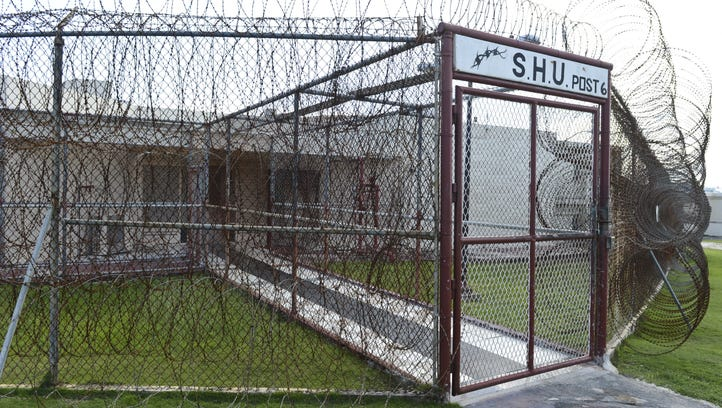 In this file photo, razor wire surrounds the special