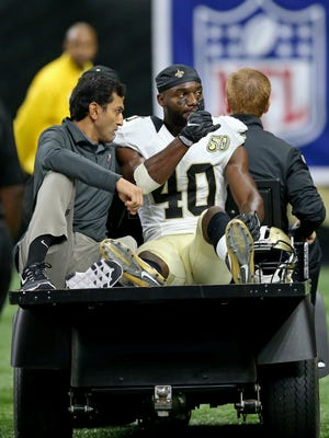 New Orleans Saints cornerback Delvin Breaux (40) is carted off the field after an injury in the second half against the Oakland Raiders at the Mercedes-Benz Superdome.