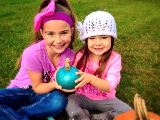 Gabriella and Mia Lupo of Chesterfield Township hold